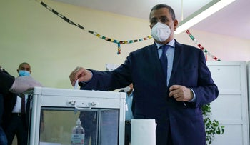 Algerian Prime Minister Abdelmadjid Djerad casts his ballot at a polling station in the capital Algiers, during a vote for a revised constitution, on November 1, 2020.