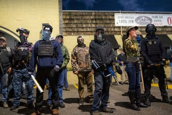 Right-wing militia members guard a business after Clark County Sheriffs deputies shot and killed a 21 year-old black man, Kevin E. Peterson Jr. Vancouver, Washington. October 30, 2020