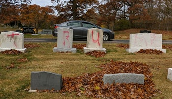 "Graves are tagged with graffiti reading ""Trump"" at a Jewish cemetery in Grand Rapids. The graffiti was discovered on November 2, 2020."