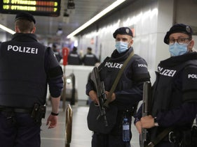 Policemen patrol at a subway station in Vienna on November 3, 2020, a day after a shooting at multiple locations across Austrian capital.