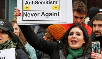 Laura Loomer holds up a sign across the street from a rally organized by Women's March N.Y.C.,  January 19, 2019.