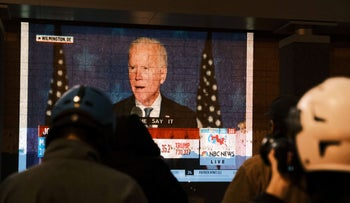 People watch Biden give a speech shortly after midnight on Election Day on November 4, 2020 in Washington, DC.