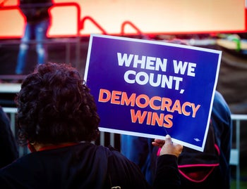 A person holds a placard calling to keep the vote count going, amid claims of irregularities by the Trump campaign during the People's Watch Party, Washington, D.C., November 4, 2020.