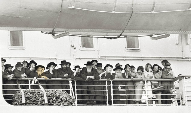 The Satmar rebbe embarking on a journey to Israel from New York, in 1965. Unlike other leading rabbis, his trips were preceded by a well-oiled public relations campaign.