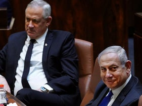 Israeli Prime Minister Benjamin Netanyahu and alternate PM Benny Gantz during a swearing-in ceremony of the new government in Jerusalemת  May 17, 2020.