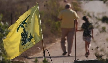 A Hezbollah flag hangs on a concrete barrier in southern Lebanon on the border with Israel, Aug. 26, 2020.