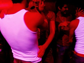 Clubbers mingle at the Vox nightclub in Tel Aviv.