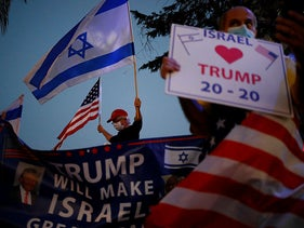 Supporters of U.S. President Donald Trump wave Israeli and US national flags on the day of the U.S. presidential election, in Carmiel, northern Israel, November 3, 2020.