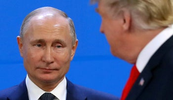 Russia's President Vladimir Putin and U.S. President Donald Trump are seen during the G20 summit in Buenos Aires, Argentina, November 30, 2018.