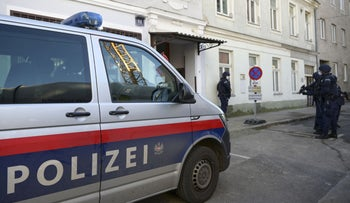 Austrian policemen stand guard a street near Tewhid mosque at the Murlingengasse in Vienna, November 6, 2020,