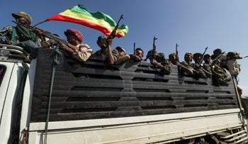 Members of Amhara region militias ride on their truck as they head to face the Tigray People's Liberation Front (TPLF), in Sanja, Amhara region near a border with Tigray, Ethiopia November 9, 2020.