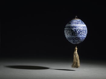 An early Iznik blue and white calligraphic pottery hanging ornament, Turkey, circa 1480 (est. £200,000-£300,000).
