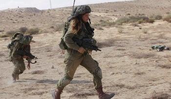 A female IDF combat soldier in a training exercise in the south, August 31, 2015.
