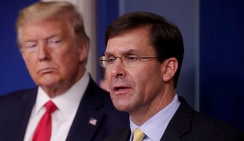 Donald Trump listens to Mark Esper address the daily White House coronavirus response briefing with members of the administration's coronavirus task force at the White House, March 18, 2020.