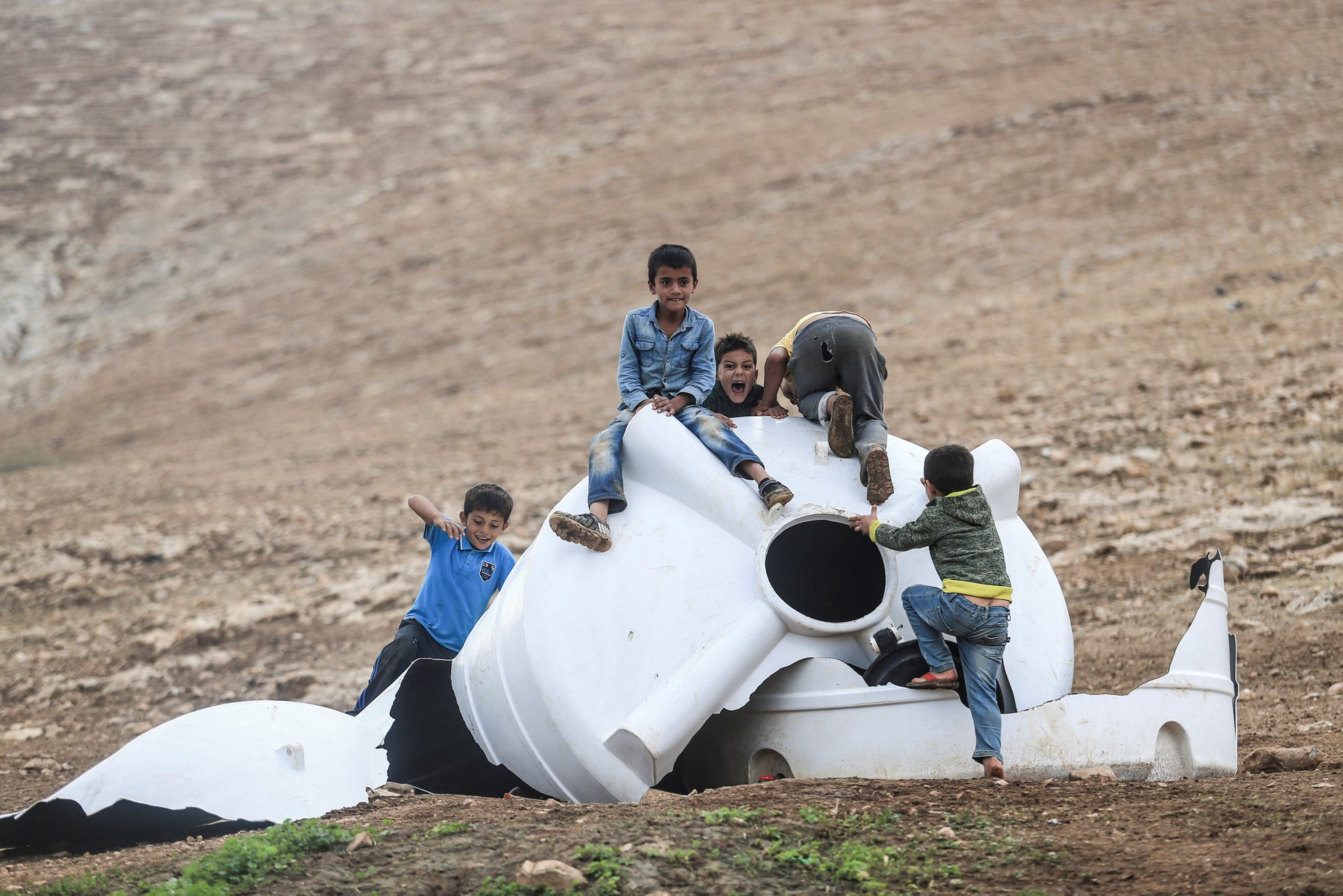 Children play in the ruins of Khirbet Humsa after its demolition, November 2020.
