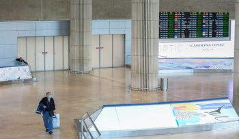 A man comes out of the generally busy arrivals hall at Ben Gurion international airport, near Tel Aviv, March 12, 2020.