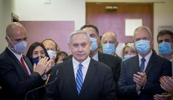Prime Minister Benjamin Netanyahu gives a statement to the media before the first session of his trial in the Jerusalem District Court, May 24, 2020.