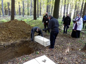 A Christian burial service for the human remains unearthed in Jaslo, October 2020.