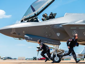 F-35 Lightning II demonstration team members sprint to their positions during the ground show at  the Defenders of Liberty Air & Space Show at Barksdale Air Force Base, May 17, 2019.