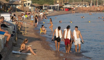 People at a beach in Eilat, 2019.