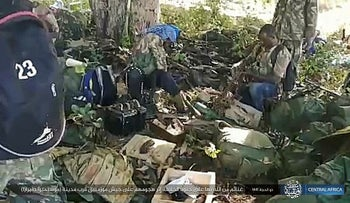 This image distributed online by the Islamic State Central Africa Province (ISCAP) and provided by SITE Intelligence Group shows ISCAP fighters and weapons following clashes with Mozambican government troops on Thursday, Aug. 6, 2020