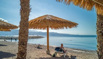 A woman relaxes at Sandy Beach in Eilat, November 9, 2020.