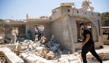The demolition of a house built without a permit in the Arab town of Arara last year.
