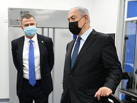Prime Minister Benjamin Netanyahu and Health Minister Yuli Edelstein at the new COVID testing lab at Ben-Gurion Airport, November 9, 2020.