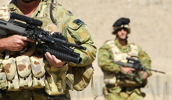 Australian soldiers on patrol in the Baluchi Valley, Afghanistan, March 10, 2010.