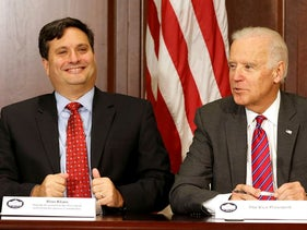 U.S. Vice President Joe Biden (R) is joined by Ebola Response Coordinator Ron Klain (L) in the Eisenhower Executive Office Building on the White House complex in Washington, U.S. November 13, 2014