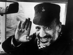 Palestinian Liberation Organisation chairman Yasser Arafat waves good-bye from his car 20 December 1983, Tripoli, Lebanon