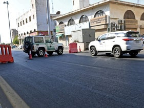 Saudi police close a street leading to a non-Muslim cemetery in the Saudi city of Jeddah where a bomb struck a World War I commemoration attended by European diplomats on November 11, 2020.