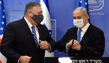 Pompeo and Netanyahu wearing face masks bump elbows after a joint news conference in Jerusalem, August 24, 2020.