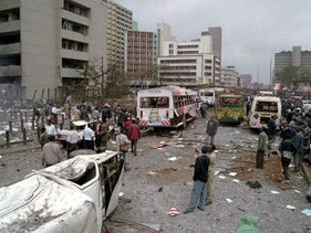 Damaged vehicles and shattered glass cover the ground after a huge explosion in Nairobi, Kenya, Friday, Aug. 7, 1998.