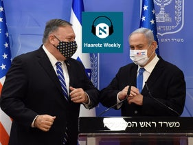 U.S. Secretary of State Mike Pompeo and Israeli Prime Minister Benjamin Netanyahu bump elbows after  a joint news conference in Jerusalem on August 24, 2020.