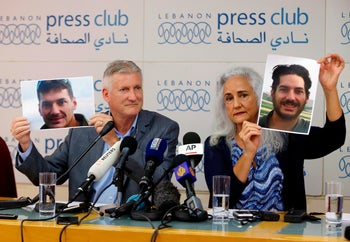 Marc and Debra Tice, the parents of Austin Tice, who has been missing in Syria since August 2012, hold up photos of him during a new conference, at the Press Club, in Beirut, Lebanon, July 20, 2017.