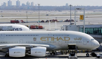 An Etihad plane stands parked at a gate at JFK International Airport in New York, March 21, 2017.