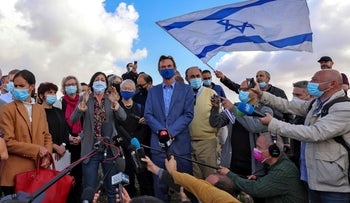 The EU representative in the Palestinian territories attempts to give a statement to the press as protesters shout slogans and wave Israeli flags in east Jerusalem on November 16, 2020.
