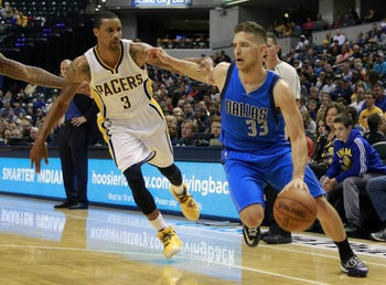 Dallas Mavericks guard Gal Mekel, right, pushing his way around Indiana Pacers guard George Hill in the first half of a preseason NBA basketball game in Indianapolis, October 18, 2014.