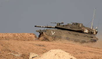 An Israel Defense Forces tank near the border with Gaza, November 11, 2020.