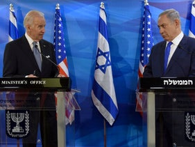 President-elect Joe Biden (L) and Prime Minister Benjamin Netanyahu look at each other as they deliver joint statements during their meeting in Jerusalem March 9, 2016.