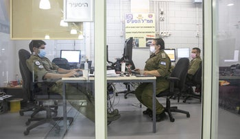 Israel Defense Forces soldiers working at the Home Front Command headquarters in Ramle, May 8, 2020.