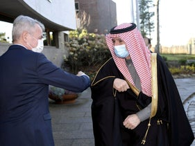 Finland's Foreign Minister Pekka Haavisto greets Saudi Arabia's Minister of State for Foreign Affairs Adel al-Jubeir in Helsinki, Finland. November 9, 2020.