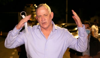 Benny Gantz emerges to face protesters demonstrating near his home in Rosh Ha'ayin, August 9, 2020.