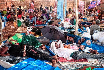 Ethiopian refugees who fled fighting in Tigray province lay in a hut at the Um Rakuba camp in Sudan's eastern Gedaref province, on November 16, 2020.