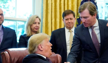 Trump shakes hands with Chris Krebs, the director of the Cybersecurity and Infrastructure Security Agency (CISA) at the White House in Washington, November 16, 2018.