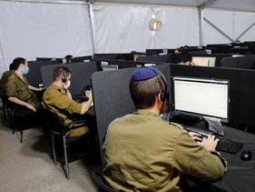 Soldiers at work in a Home Front Command coronavirus epidemiological investigation center, in Ramle, September 29, 2020.
