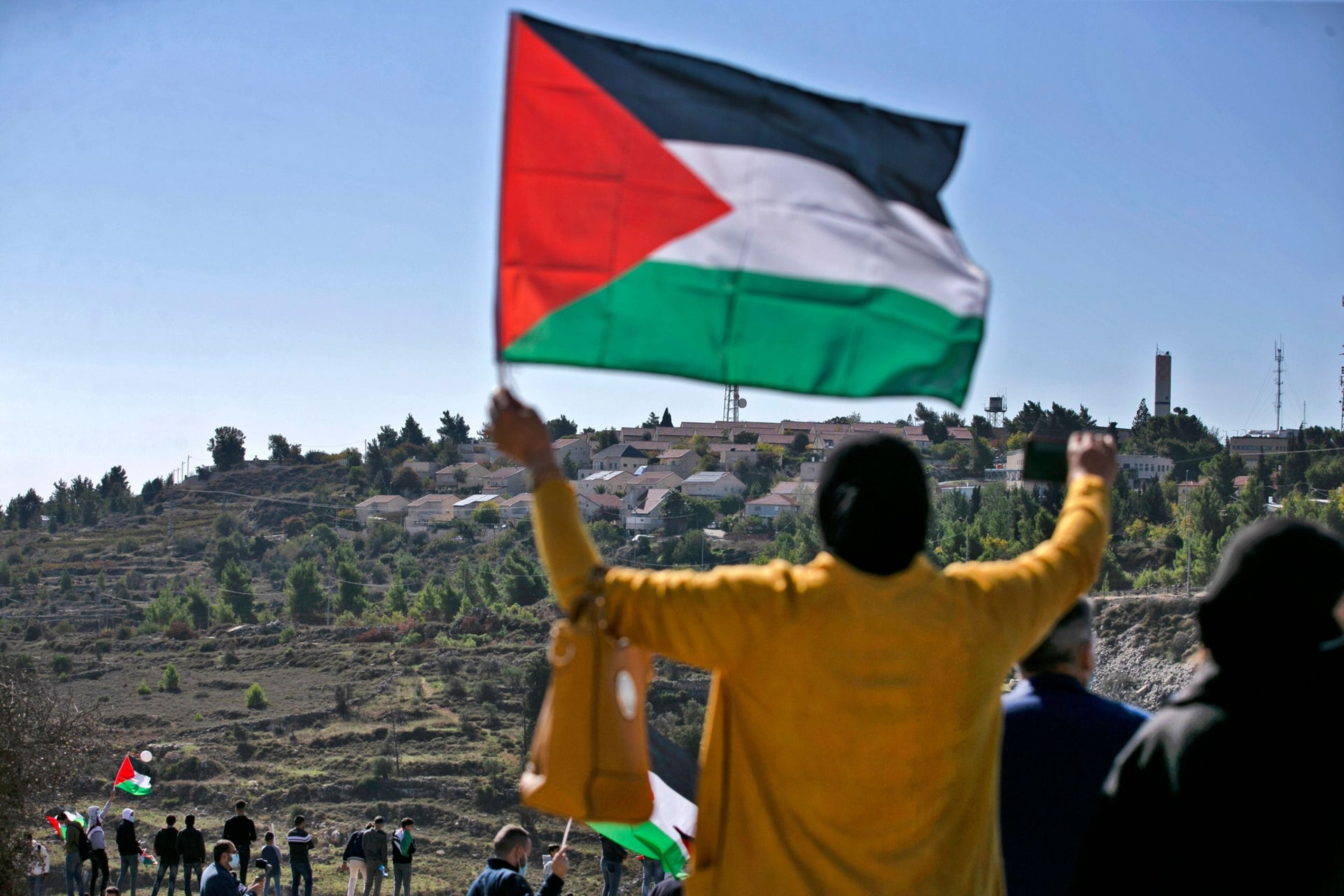 Palestinians protesting against expected visit of U.S. Secretary of State Mike Pompeo to the Jewish settlement of Psagot near the West Bank city of Al-Bireh, November 18, 2020.