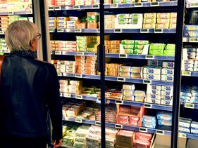 File photo: A woman looks at butter packages on refrigerated supermarket shelves in Nantes, western France, October 20, 2017.