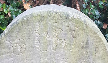 A swastika carved into a headstone at the Jewish cemetery of Haren, Germany in November 2020.